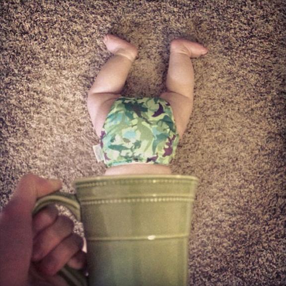 Baby hidden in a mug